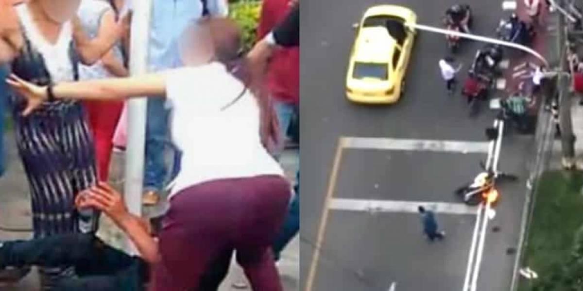 Mujer defendió a fletero de golpiza de la gente y se llevó unos cuantos golpes