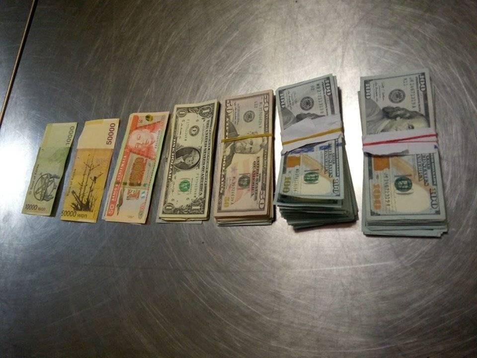 dólares decomisados a coreana en el aeropuerto