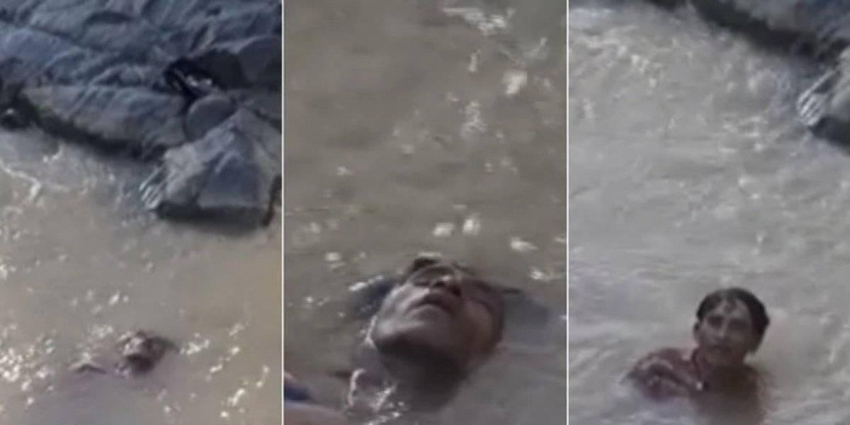 Moradores encontram 'corpo' em rio, mas descobrem que homem estava apenas dormindo depois de ter bebido demais