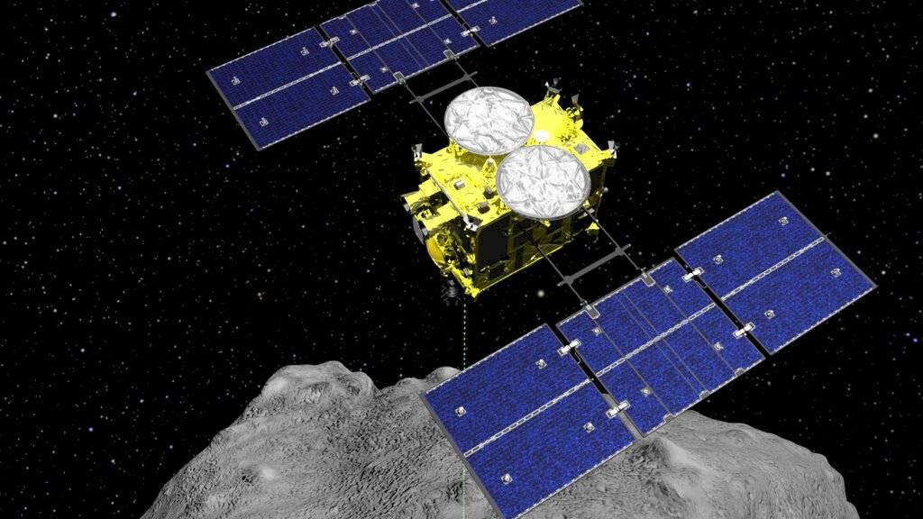 En esta imagen gráfica por computadora de archivo, publicada por la Agencia de Exploración Aeroespacial de Japón, se muestra la sonda Hayabusa2 sobre el asteroide Ryugu.