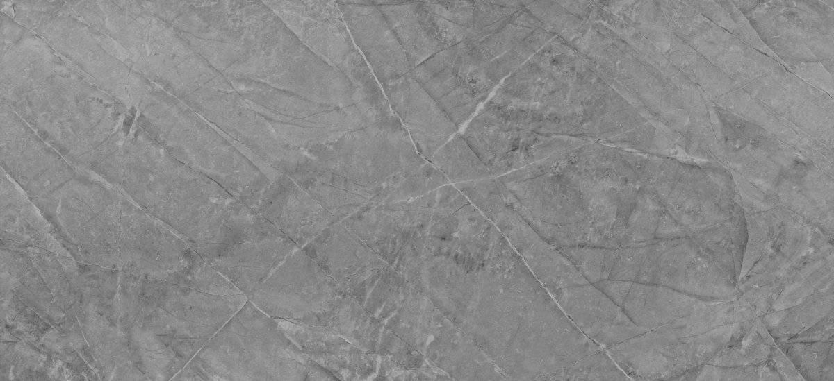Sogne: Captura la distinguida belleza erosionada de la piedra natural Gris Pulpis. Con una textura que combina la piedra natural y el hormigón envejecido, evoca una estética industrial con la yuxtaposición de su brillo ultraintenso. Cortesía: Cosentino