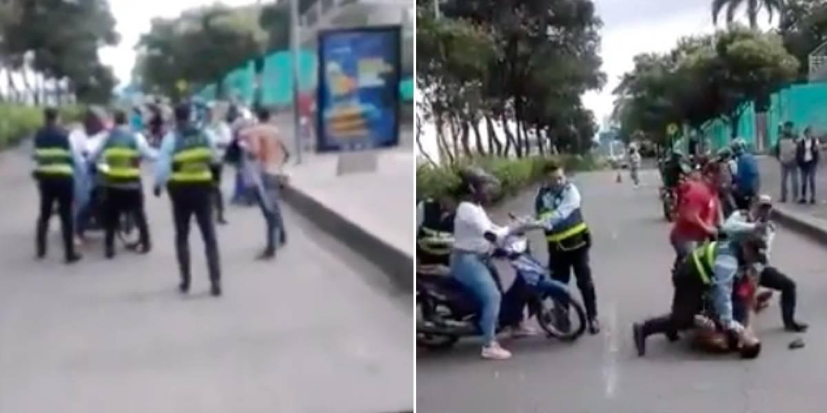 En video quedó registrado el momento en que motociclista se va a los golpes con agentes de tránsito