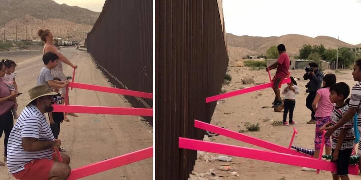 El sube y baja que traspasa el muro entre Estados Unidos y México