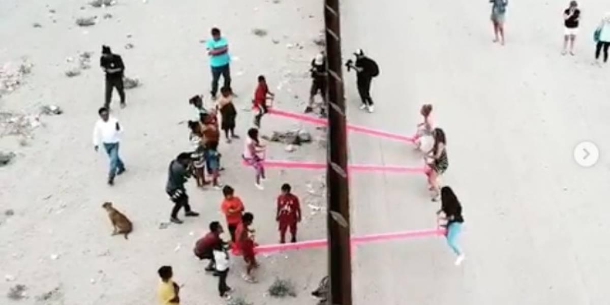 Gangorra em fronteira entre EUA e México permite que crianças de ambas nações brinquem juntas