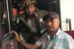 Mayor Marco Antonio Barrios, de los Bomberos Voluntarios, y Ewwin René Rivera.