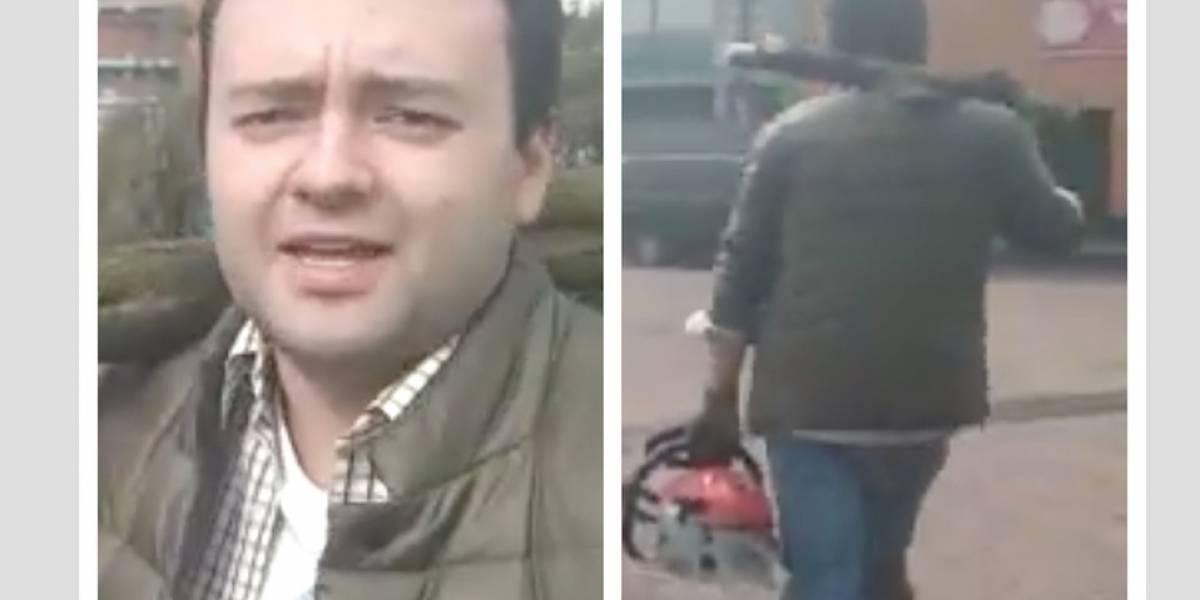 (VIDEO) La curiosa respuesta de hombre captado en Bogotá cargando una motosierra y un tronco