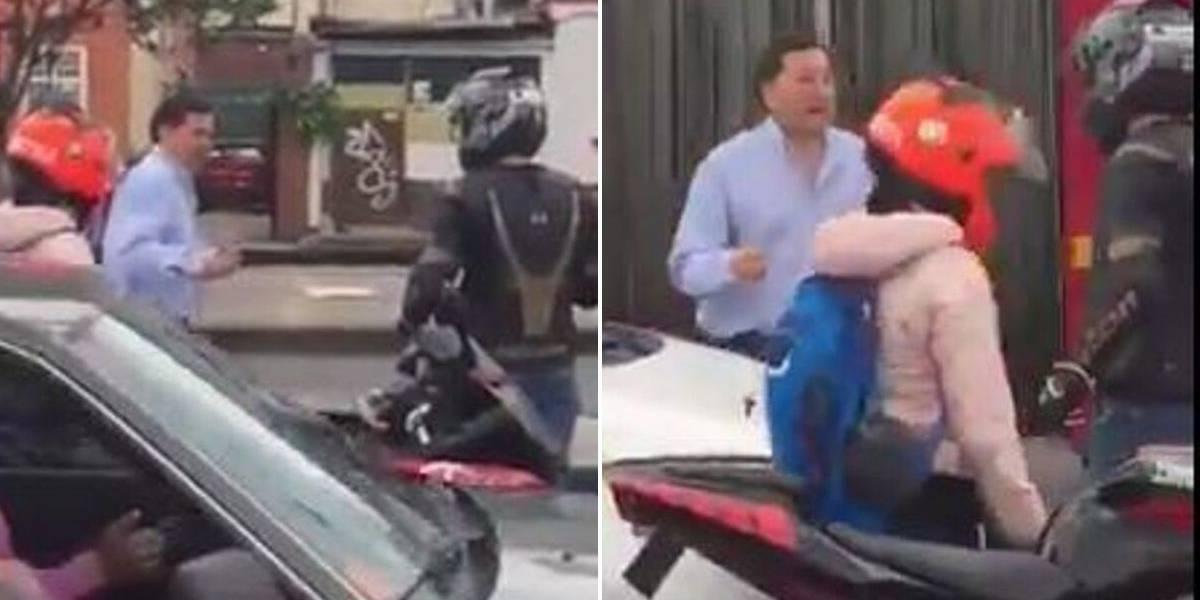 (VIDEO) Fuerte pelea entre motociclista y conductor de vehículo particular generó caos vial en Bogotá