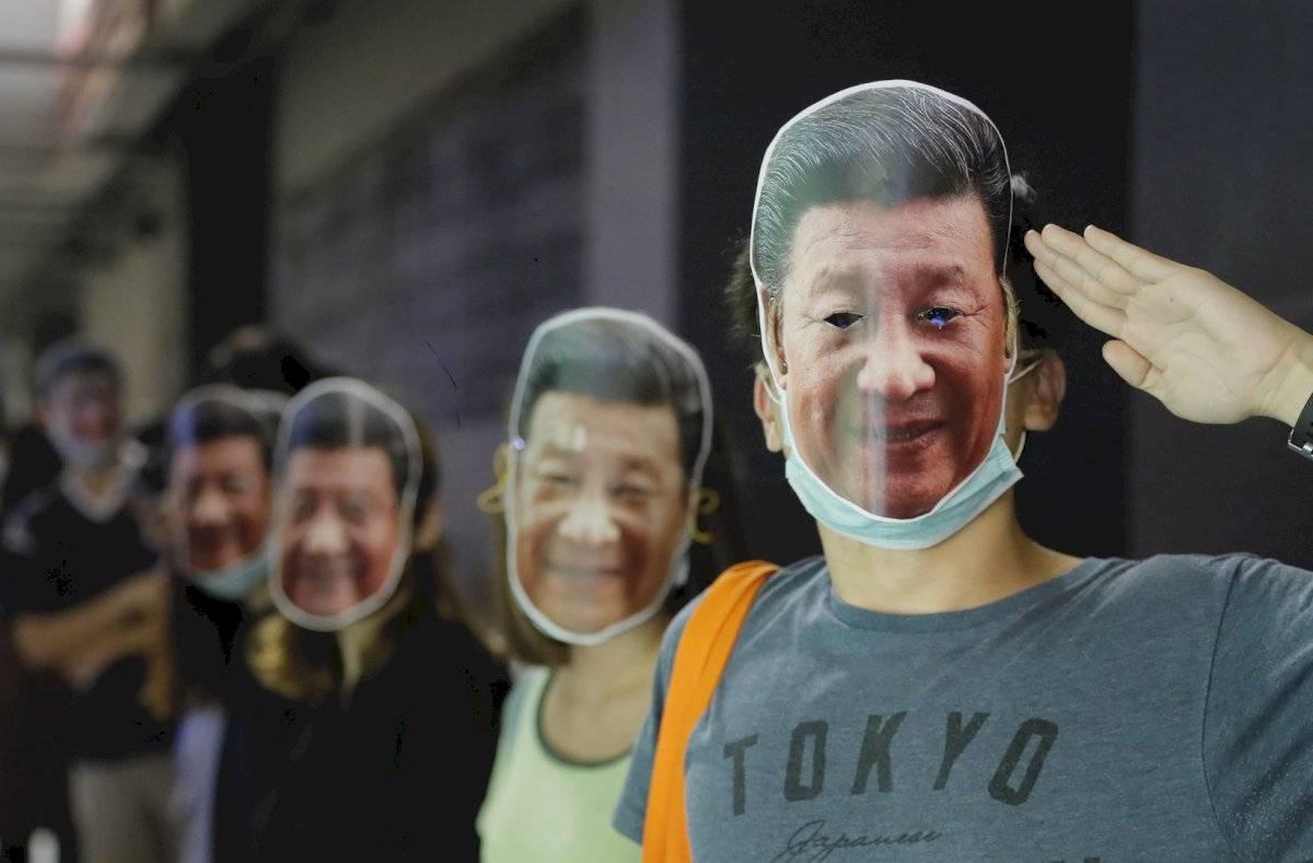 Algunos utilizaron la cara de Xi Jinping, presidente de China, quien representa el gobierno contra el que se manifiestan