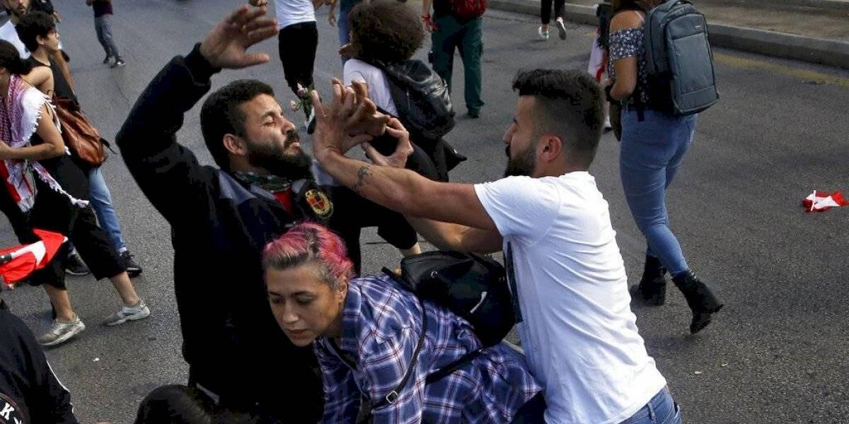 Libaneses atacan a manifestantes en 13er día de protestas