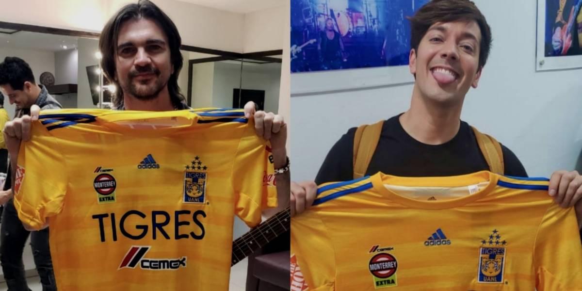 Juanes y Roger González lucen con el jersey de Tigres