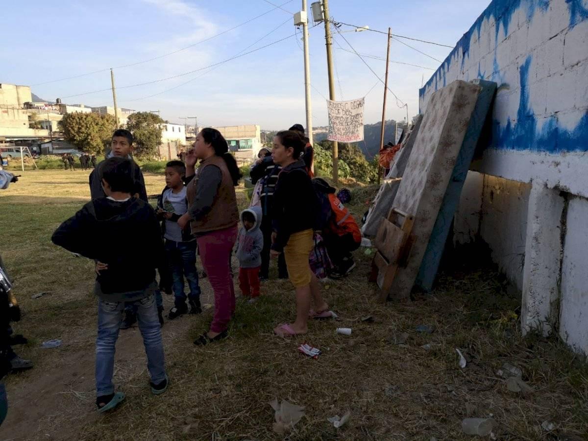 traslado de familias de Ciudad Peronia a albergue