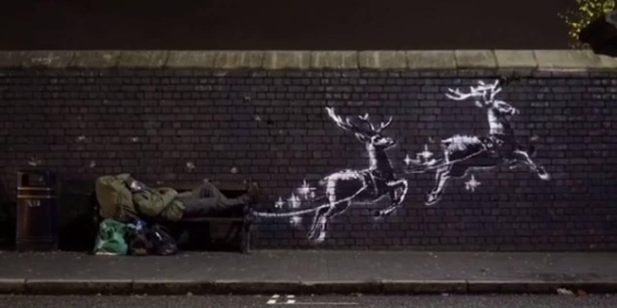 Banksy divulga grafite natalino em muro na Inglaterra e viraliza nas redes sociais