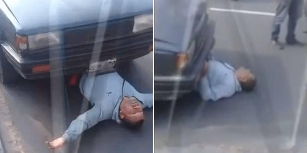 (VIDEO) Conductor se hizo debajo de su carro para que no fuera llevado por la grúa