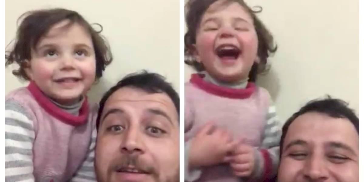Una acción desesperada en medio de la guerra: el padre sirio que inventó un juego y hace reír a su hija cuando caen las bombas