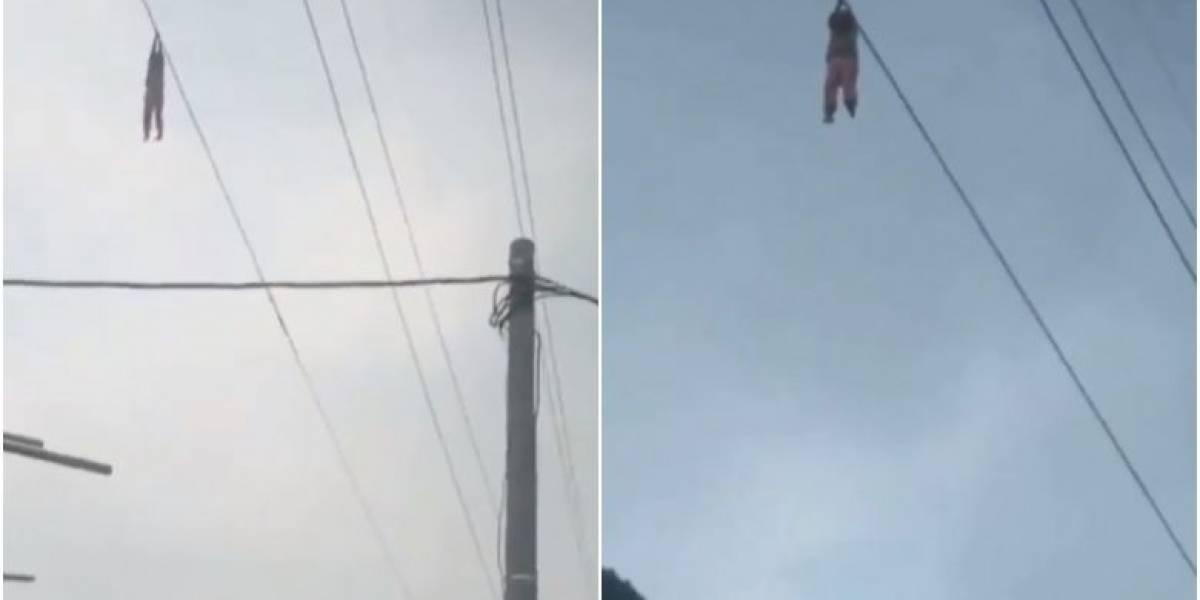 Vídeo de menina pendurada em cabo de eletricidade a 15m de altura é real e autoridades explicam o ocorrido