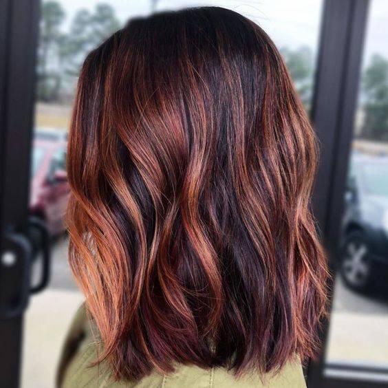 Reflejos en tonos rojizos para cabello oscuro