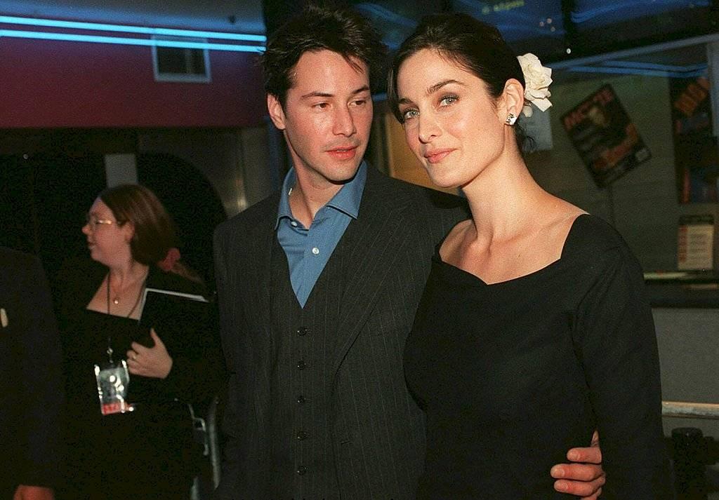 Keanu Reeves e Carrie-Anne Moss