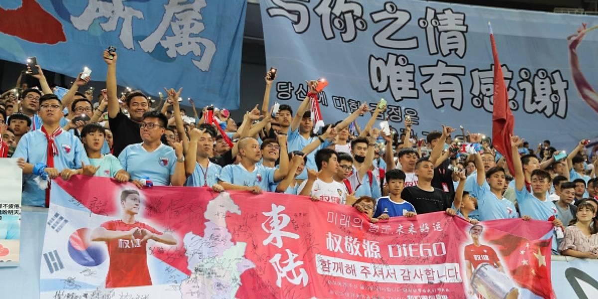 Torcedores começam a voltar aos estádios de futebol na China