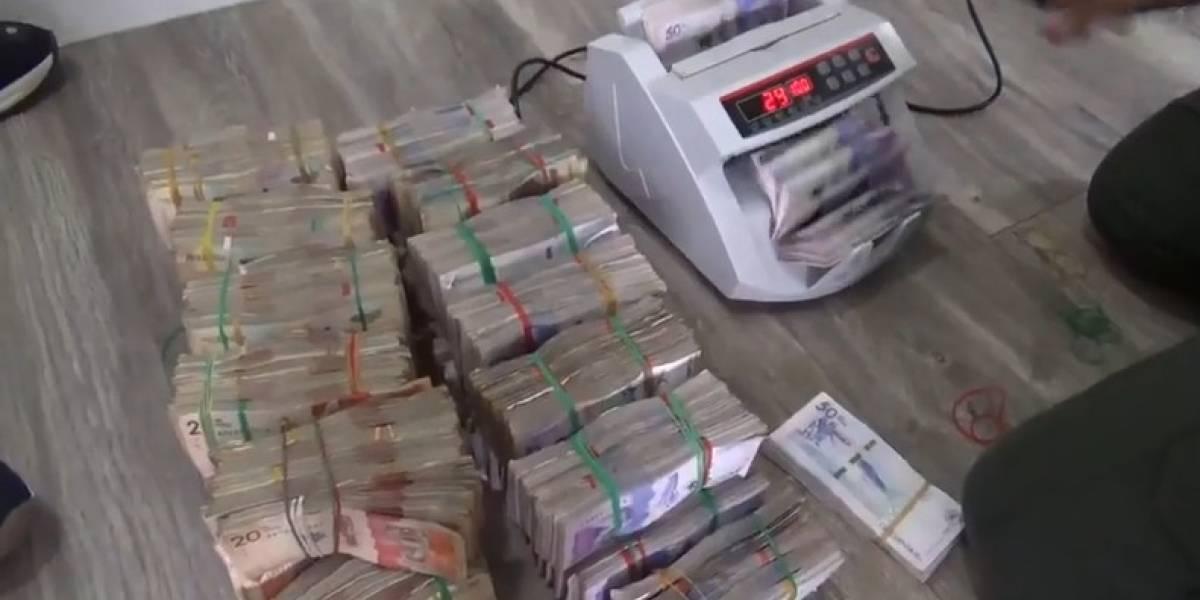 En cajas de cartón, autoridades hallaron caleta con más de $8000 millones