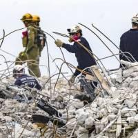 Encuentran cuerpo de otra puertorriqueña en los escombros de edificio en Miami