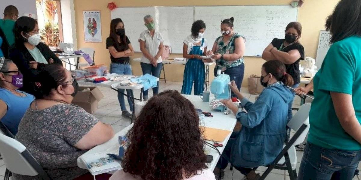 Mujeres Empresarias gestionan mercado en la montaña para promover el auto sustento económico
